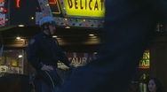 Stock Video Footage of NYC Cop & horse next to Deli sign