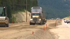 construction highway building, #7 grader leveling dirt with dump truck - stock footage