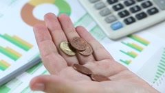 Counting coins  of Green Finance Stock Footage