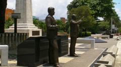 Statues of USA Presidents - John F. Kennedy on the left Stock Footage