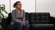 Woman applying for job, in waiting room Stock Footage