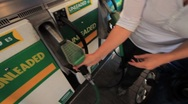 Stock Video Footage of Woman Fills Car at Gas Station with Gas or Petrol GFHD