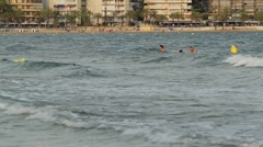 People swimming near the beach Stock Footage