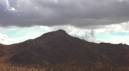 Stock Video Footage of Rain Clouds Over Mountains Mojave Desert 2