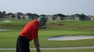 Stock Video Footage of golfer swings hurt his shoulder