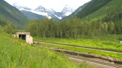 Railroad, Coal train exiting MacDonald Tunnel Stock Footage