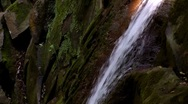 Stream of water running over rocks Stock Footage