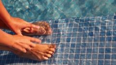 Two legs and two arms shown in pool water Stock Footage
