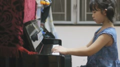 Asian kid playing piano - stock footage