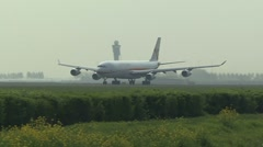 Commercial airplane from Surinam Airways is taking off on runway Stock Footage