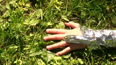 Hand grips and fetches the grass Stock Footage