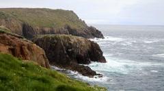 Waves crash onto rocks at Land's End (Cornwall, England) - stock footage