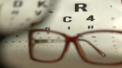 Eye test and red eyeglasses Stock Footage