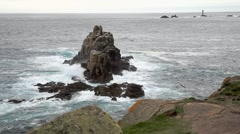 Waves crash onto rocks at Lands End (Cornwall, England) - stock footage