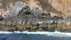 wave swells over rocks 1 - stock footage