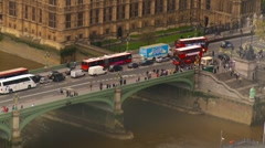 Buses and people crossing the Westminister Bridge Stock Footage