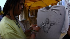 Painting on T shirt with airbrush Stock Footage