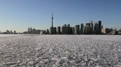 Moving across a frozen Lake Ontario towards the Toronto harbour Stock Footage