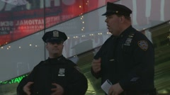 Two NYC cops hang out in Times Square Stock Footage
