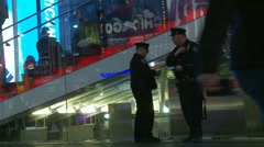 Two NYC cops hang out in Times Square - Wide shot Stock Footage
