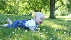 Baby crawls through grass - stock footage