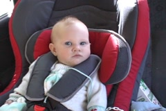 Baby in car seat - stock footage