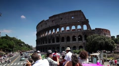 Tourists riding in an open bus on the way past the Coliseum Stock Footage