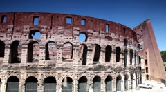 The Coliseum facade shown in motion, then shows some area near Stock Footage