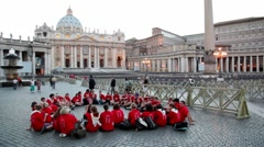 People are on international pilgrimage on square near Saint Peters Cathedral Stock Footage