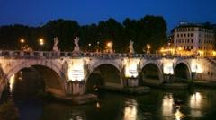 People walk along Sant Angelo Bridge at night Stock Footage