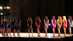 Participants Miss Rome 2010 in evening dresses walk on podium on Navona Square Stock Footage