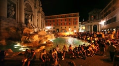 Tourists around Trevi Fountain at evening, people admire impressive art Stock Footage