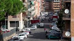 Town street from above, many cars parked on each side Stock Footage