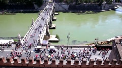 Bridge over river, street traffic on one riverside and quay with tourists Stock Footage