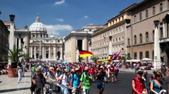 People are on pilgrimage on street leading to the Saint Peter's Cathedral Stock Footage