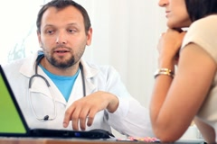 Male doctor talking with female patient NTSC - stock footage