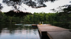 Swimmers off dock time lapse Stock Footage