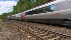 Virgin Express train speeding past L-R Stock Footage