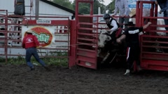 Stock Video Footage of Stock Footage - Rodeo - Bull rider falls off bull