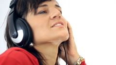 Woman in headphones listening to the music, isolated HD Stock Footage