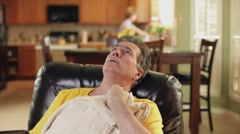 Sick man in an easy chair Stock Footage
