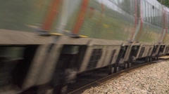 Virgin train coming round a bend Stock Footage