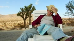 Man Napping In Desert Looks Around Stock Footage