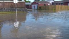 Disaster, flooded street in residential neighborhood Stock Footage