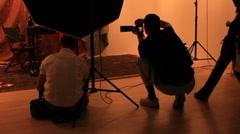 Photographers in studio Stock Footage