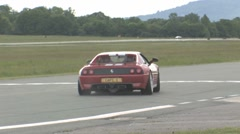 Ferrari sliding on to race track Stock Footage