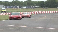 Ferrari power sliding on race track Stock Footage