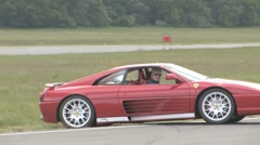 Ferrari spins on the race track Stock Footage