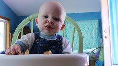 Baby spits out piece of bread Stock Footage