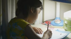 Asian kid doing homework Stock Footage